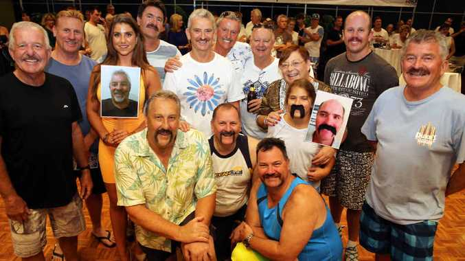 GROW THAT MO: Simmo's Dirty Dozen and representatives for those who could not attend at Simmo's Backyard Barbecue at the C.ex Coffs on Wednesday night.