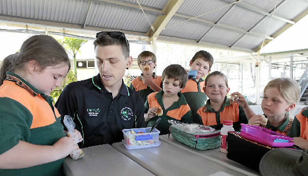ROLE MODEL: Dan Horton has lunch with the kids every day.