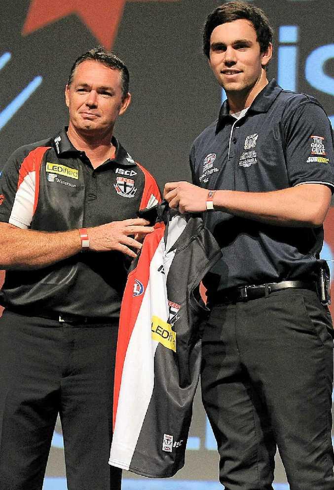 TOP PROSPECT: St Kilda coach Alan Richardson presents No.1 pick Paddy McCartin with the Saints jumper at last night's AFL draft on the Gold Coast.