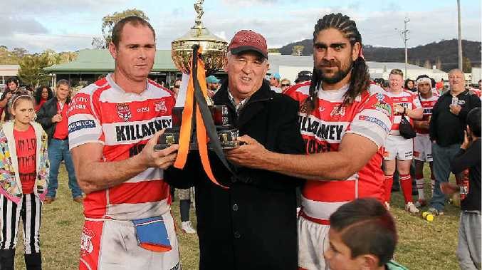 """PREMIERS: Killarney Cutters vice-captain Leejay Cooper and captain-coach John Trindall with BRL president Neil """"Casey"""" O'Connor after the 2014 grand final."""