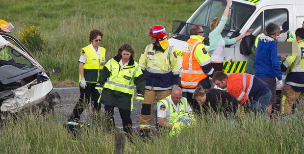Emergency services staff tend to the injured.