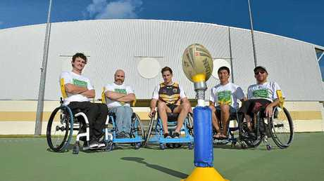 LEAGUE OF THEIR OWN: Sunshine Coast Falcons colts player Rohan Messer (centre) with Australian wheelchair rugby league players (from left) Mitchell Stone, Yarra Ryan, Laurie Lawira and Ralph Hasna.