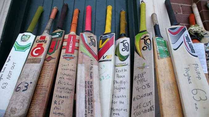 A row of bats with messages are lined up as a tribute for Phillip Hughes at the Sydney Cricket Ground.