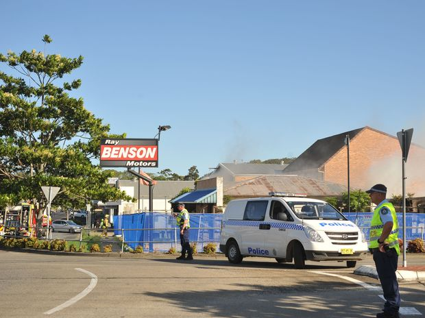 Police direct operations at the scene of the fire in Park Avenue at Coffs Harbour.