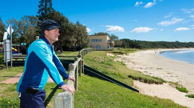 Professional lifeguard Greg Hackfath keeps a watchful eye on the ocean at Woolgoolga.