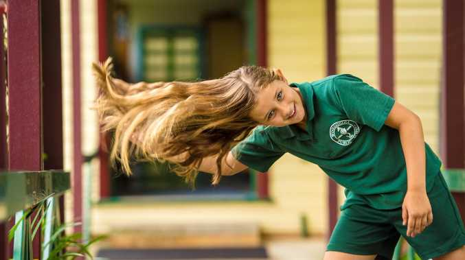 Woolgoolga Public School student Arabella Chaplin is about to shave off all her luscious locks and donate her pony tail, all in the name of helping those with cancer. Photo: Trevor Veale / Coffs Coast Advocate
