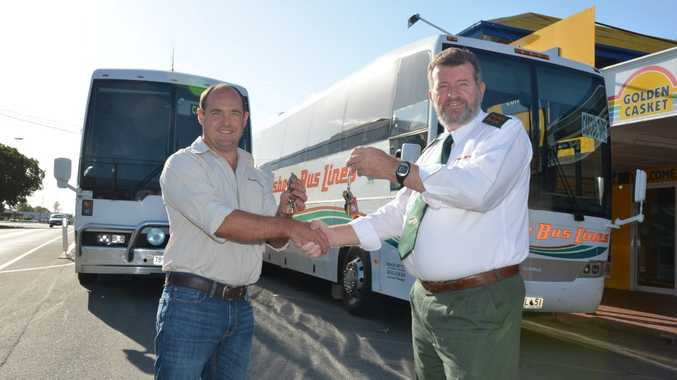 KEY EXCHANGE: Andrew Dascombe from Pursers takes over from Dale Tokely of Brisbane Bus Lines. Photo Keagan Elder / South Burnett Times