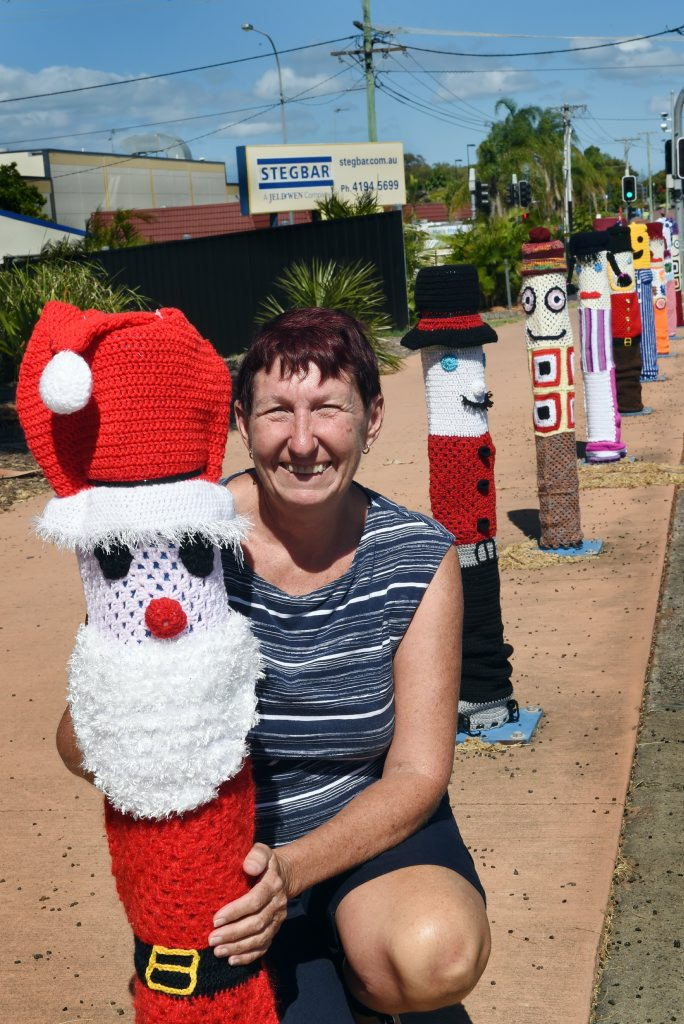 Josie Street with the yarn-bombed bollards near the cultural centre on Old Maryborough Rd in Pialba.