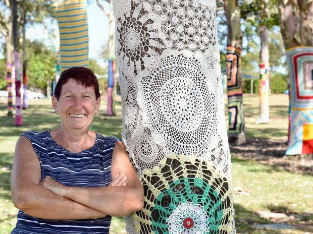 Josie Street shows off the Fraser Coast Yarn Bombing Group's handiwork.