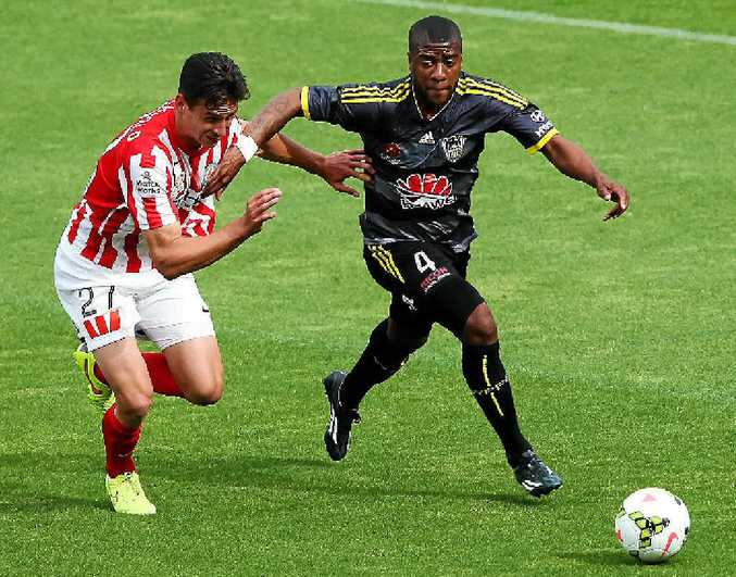 ON THE BURST: Wellington's Roly Bonevacia holds off the challenge of Melbourne City's Ross Archibald.