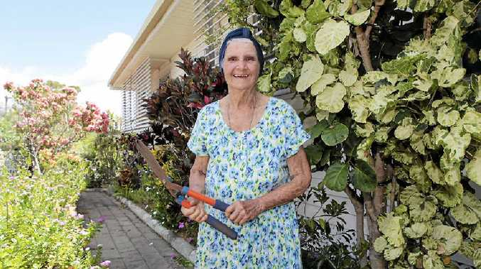 SHEAR LUCK: Gladys O'Brien is delighted that a group of strangers helped her get her garden back in shape on Sunday.