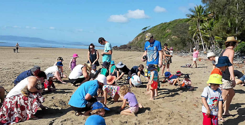 FUN TIMES: Mums, dads and children take part in the Conway Beach Tourist Park's Family Fun Weekend treasure hunt.