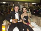( From left ) Will Hansen serenades Joumanna Haddad on their way to the Toowoomba Grammar School formal . Saturday, Nov 22, 2014 . Photo Nev Madsen / The Chronicle