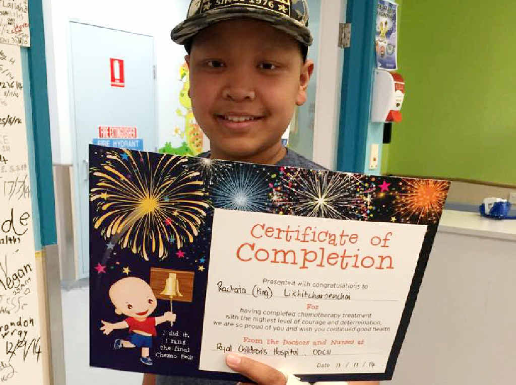 HOME FOR CHRISTMAS: Ping Chomkiattikun displays a certificate signalling his chemotherapy treatment is complete.