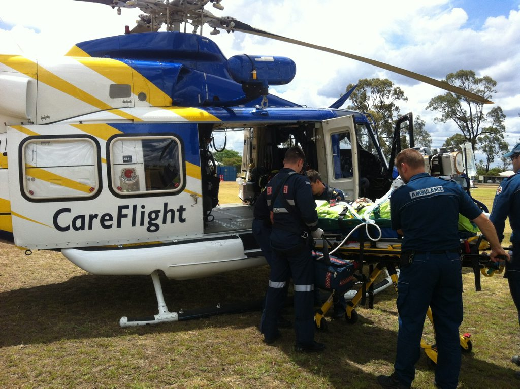 RACQ CareFlight crews transport a man injured during a campdraft event near Miles. Photo Contributed by RACQ CareFlight