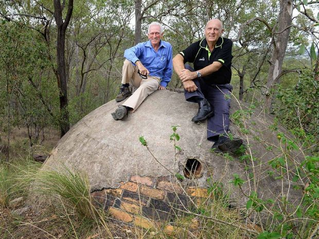 Ipswich Historical Society president Hugh Taylor and Cr Bruce Casos inspect a water tank at the site where Brynhyfryd stood at Blackstone Hill.