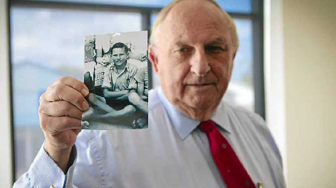 LOOKING BACK: Bill McMillan with a photo of himself at 12 years old, when he decided to be a lawyer.