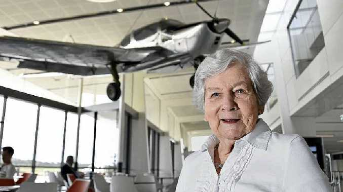 Barbara Trousdell looks over the plane piloted by her husband Ron Trousdell. The prototype was designed and built in Toowoomba and now hangs in the terminal at Wellcamp Airport.