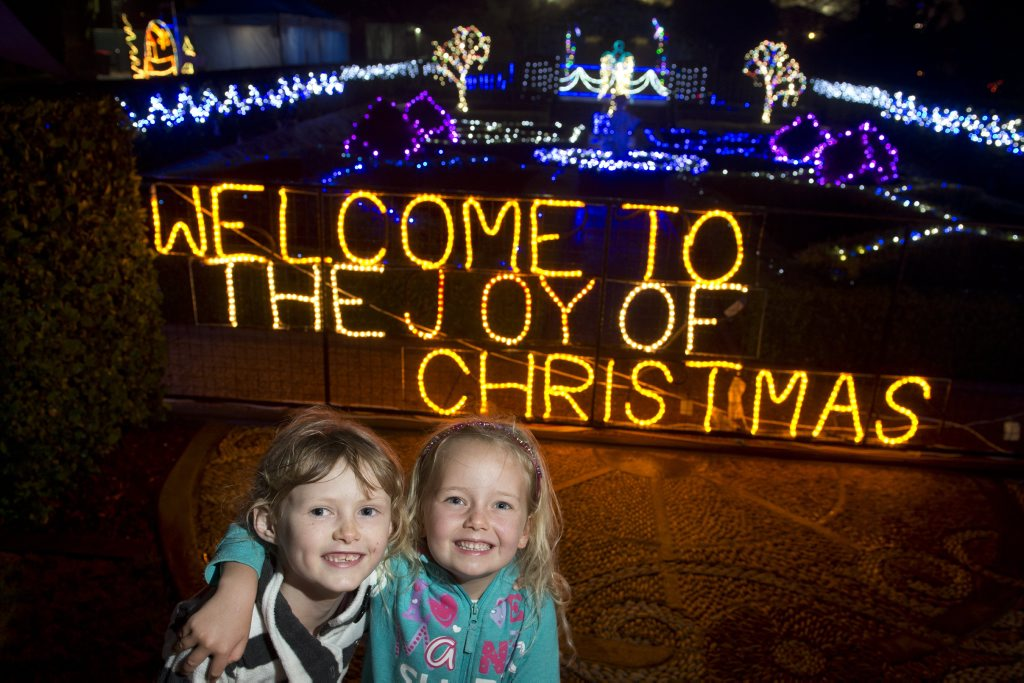 Cousins Liliane (correct) Jervis (left) and Emily Little get the first look at the 2014 Toowoomba's Christmas Wonderland at the official opening.