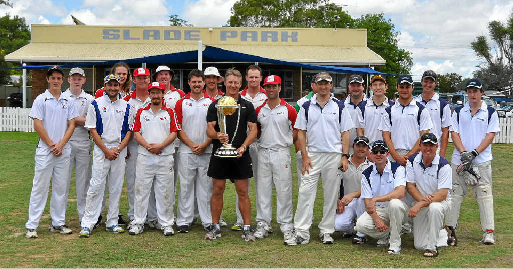 SPECIAL GUEST: 2003 ICC Cricket World Cup winner Andy Bichel poses with the ICC Cricket World Cup Trophy and players from Colts and Maryvale at Slade Park yesterday.
