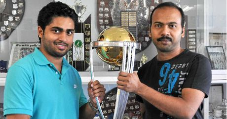 Tinu Sebastian and Sabinesh Devakumar check out the ICC Cricket World Cup trophy.
