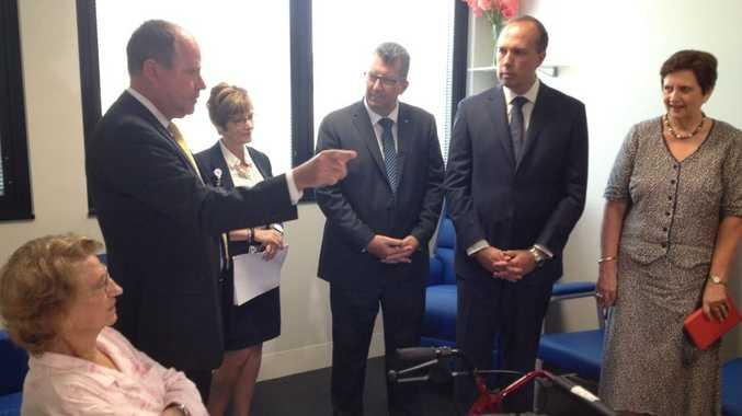 Flanked by UnitingCare Queensland chief executive officer Anne Cross (right) and Hinkler MP Keith Pitt, Health Minister Peter Dutton listens as he tours the wards at St Stephen's Hospital before officially opening the digital facility on Monday.