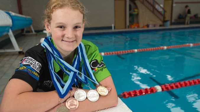 EVERY COLOUR: Madeleine McTernan shows off the one gold, three silver and one bronze medal she won at the NSW Multi-Class Championships in Sydney last week. Photo: Trevor Veale/Coffs Coast Advocate