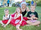 EXCITEMENT BUILDING: Danielle Eilola and her three kids Rylan, 2, Gracie, 3, and Nate, 4, enjoy an ice cream at the Carols by Candlelight.