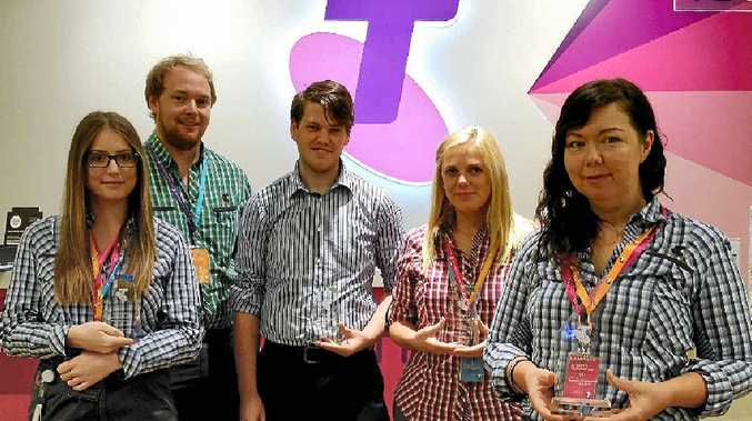 WINNERS: The Warwick Telstra Store team Jessica Naumann, Callum Harris, Alex Guymer, Nicole Rafter and Bianca Jenkins proudly display their four Telstra Awards night recognising the best stores in Southern Queensland, including Store of the Year.