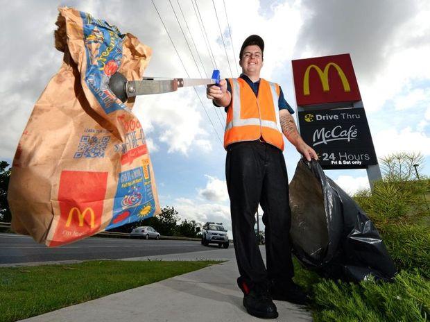 Crew Trainer Zac James picks up some rubbish at McDonalds in Murwillumbah. Photo: John Gass / Tweed Daily News
