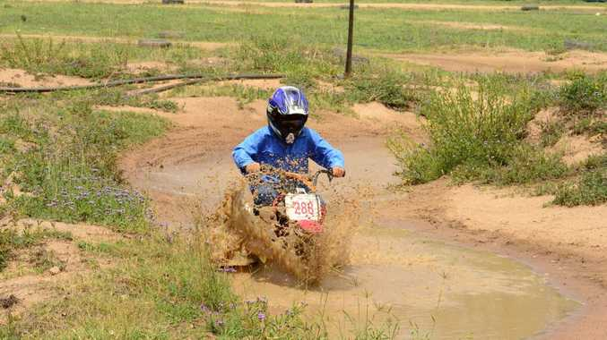 MUD AND GUTS: Lachlan Heath powers through the water on the junior track.