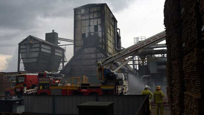 Fire crews battle a blaze at the Carter Holt Harvey sawmill on Henzell Rd on Tuesday, December 9, 2014.