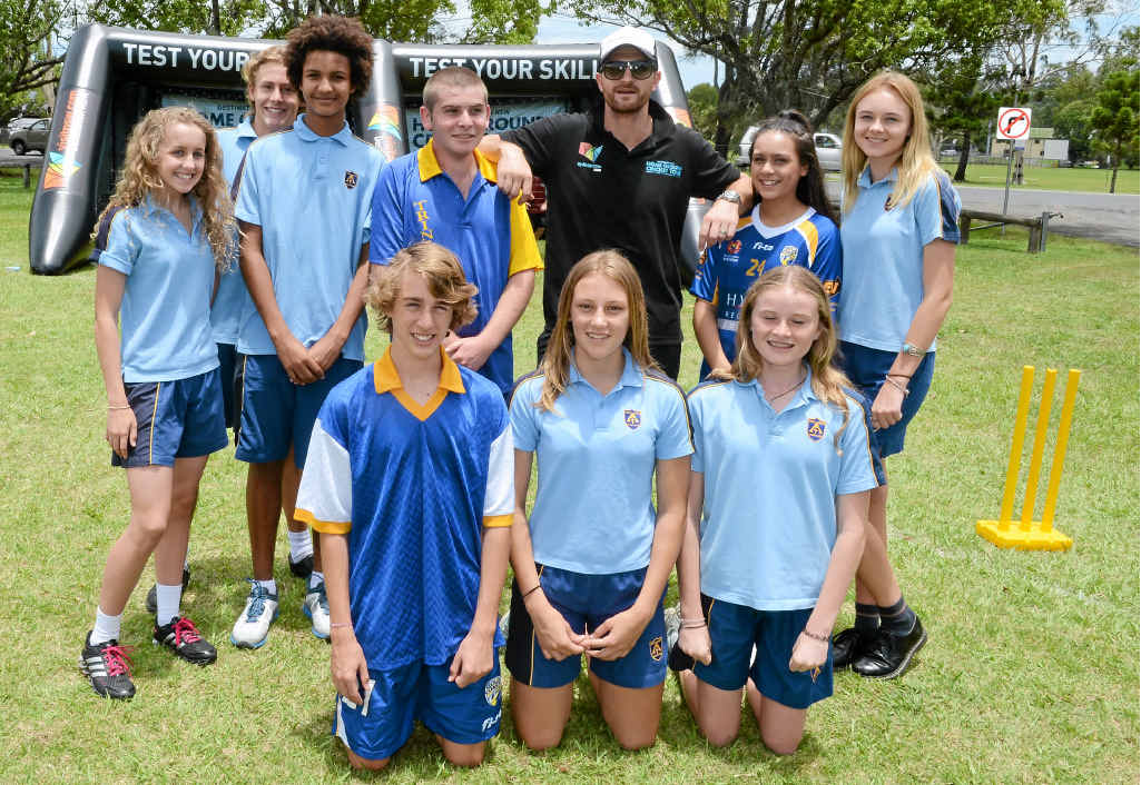 Trinity Catholic College students with cricketer Jason Krezja at the NSW Home Ground Cricket Tour visit to Mortimer Oval, Lismore.