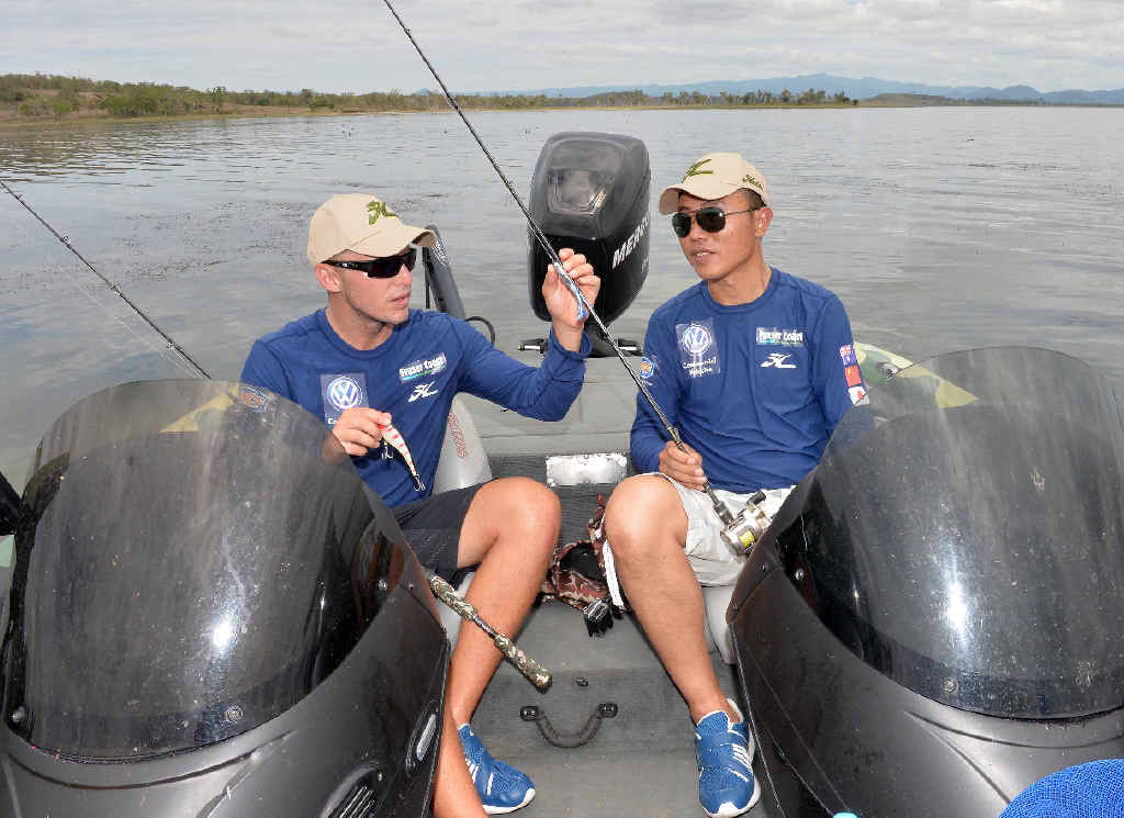 GOING FISHING: Barra anglers Carl Jocumsen, of Toowoomba, and Chinese competitor Haiyang Li, team up in the inaugural International Fishing Series at Kinchant Dam.