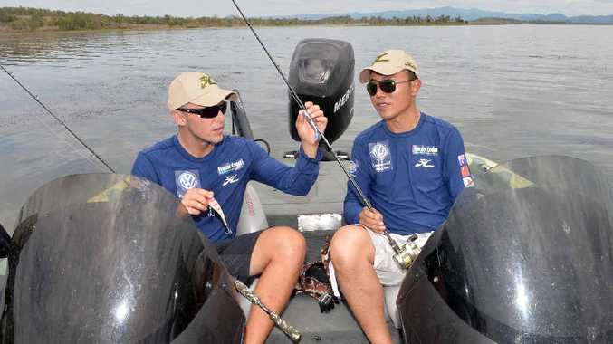 GOING FISHING: Barra anglers Carl Jocumsen, of Toowoomba, and Chinese competitor Haiyang Li, team up in the inaugural International Fishing Series at Kinchant Dam.