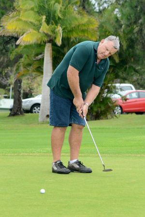 Phil Jacobson enjoying a hit at Sawtell Golf Club - one of his favourite pastimes. A golf day in his honour is being held at the club on December 28.