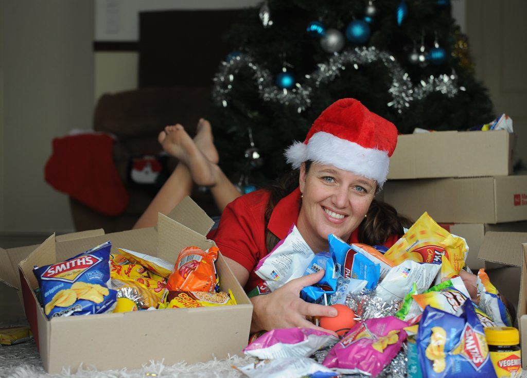 Tam Geritz with the Christmas boxes she is filling to go to our armed forces overseas.