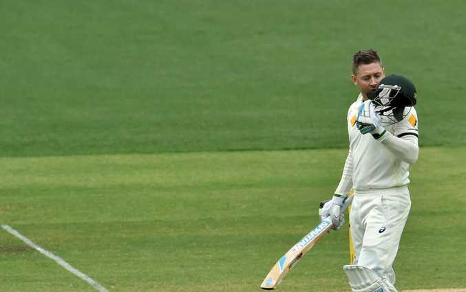 Australia's batsman Michael Clarke kisses his helmet as he celebrates his century on the second day of the first Test cricket match between Australia and India at the Adelaide Oval on December 10, 2014. AFP PHOTO / SAEED KHAN