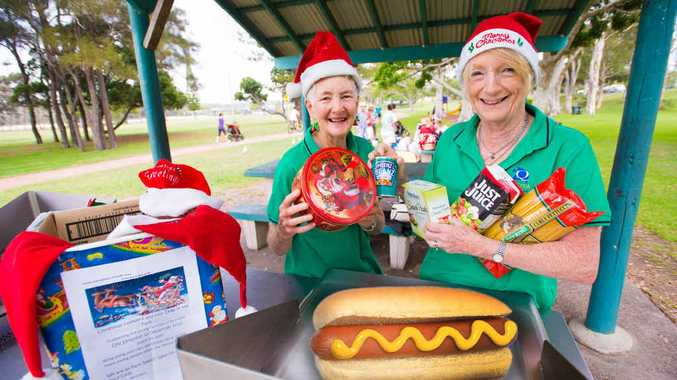 HOT HAMPERS: Dianne Egan and Jane Glover getting ready for Saturday's Quota Club Christmas collection and lunch event, Hot Dogs and Hampers in the Park. Photo: Trevor Veale