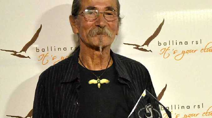 AWARD WINNER: Ivan Perger, 66, receives his first NCEIA Dolphin Award in the Folk category.