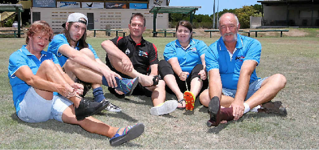 ON THE OTHER FOOT: Louisa Lumby, Pete Venarie, Kevin Fancke, Jamie Deakes and Jack Lumby, are encouraging the community to 'walk a mile in their shoes' to support those affected by suicide in the Whitsundays.