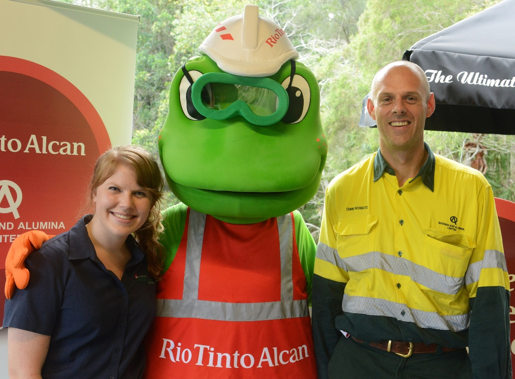 Gladstone Tondoon Botanic Gardens visitor services officer Alexis Smith (left), Rio Tinto Alcan Yarwun mascot Frankie the Frog and Queensland Alumina Limited specialist media and communications officer Chris Schultz  launch Lessons in the Garden.