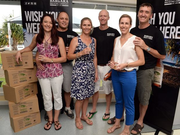 OUR OWN BEER: Estelle and Alex Pretorius, Jacinta and Jack Millbank, and Kirsty and Tim Hill are proud to be launching Bundaberg's newest brew, the Thirsty Turtle, the signature product of the Bargara Brewing Company. Photo: Max Fleet / NewsMail