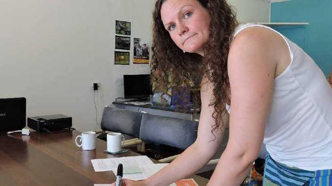 CAMPAIGN: Mackay Conservation Group volunteer Laura Cooke signs her photo petition.