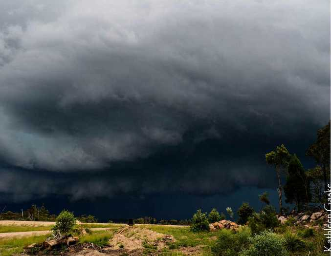 DANGER IN THE SKIES: Kathleen Gaske snapped this shot of a storm approaching Stanthorpe yesterday afternoon. Two men were hospitalised after near-misses with lightning strikes in Stanthorpe.