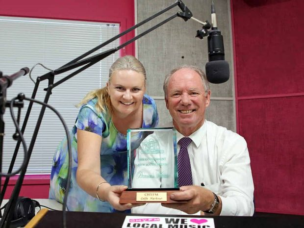 ON AIR: CHYFM station manager Becky Cole receives a Premier's Award from MP Andrew Fraser. Photo: Gemima Harvey