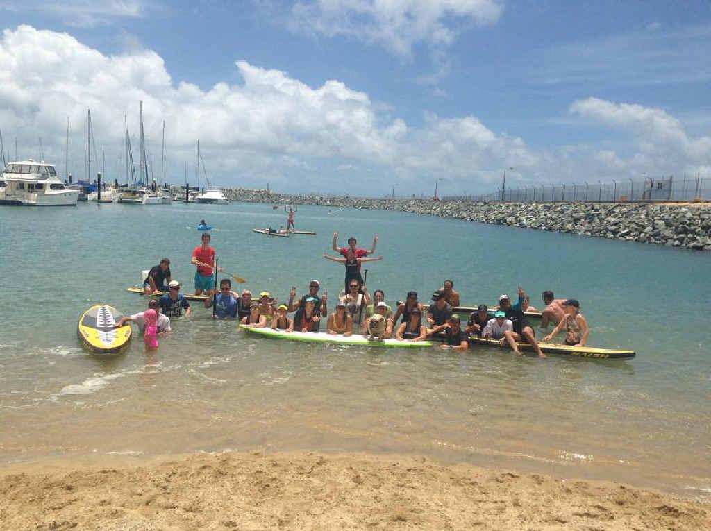 Participants at a stand-up paddle board race at Mackay Marina.