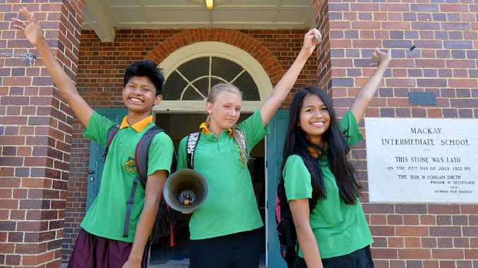 FAREWELL: Mackay Central State School Year 7 students Marcelo Memeses, Lilly Ritter and Danica Belonio celebrate their last day of primary school before heading to high school next year. Students who have completed Year 6 will also attend high school for the first time.