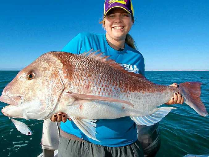 MEASURES UP: A 102cm snapper like this one is well within the law.
