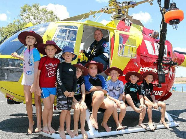 ON THE WATER: Mt Tarampa students checked out the Surf Life Saving Queensland rescue chopper with pilot George Levett, during the annual Seqwater Play it Safe day on Wivenhoe Dam on Wednesday, December 3.